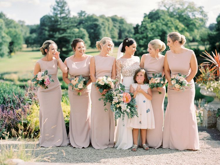 Bridal Party Portrait with Bridesmaids in Pink Dress and Bride in a Rime Arodaky Wedding Dress
