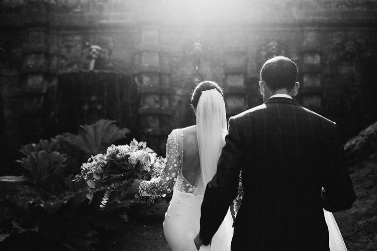 Black and White Portrait of Bride in Rime Arodaky Wedding Dress Applique Long Sleeves