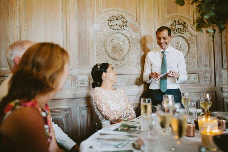 Bride in Applique Rime Arodaky Long Sleeve Wedding Dress Laughing During Wedding Speeches