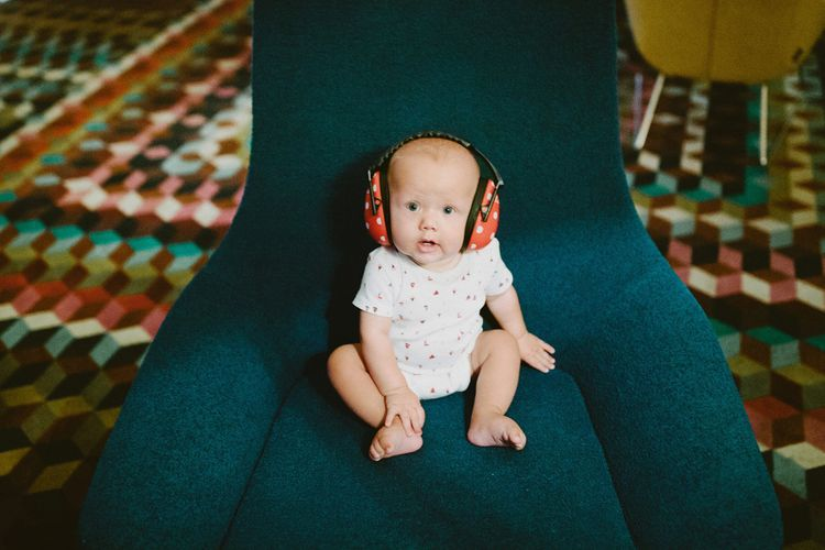 Cute Baby in Noise Cancelling Headphones