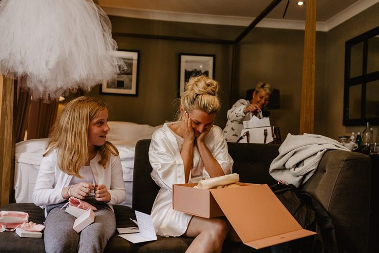 Bride Opening a Gift Box From Her Groom on The Wedding Morning