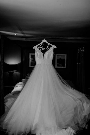 Stella York Wedding Dress Hanging Up on a Bride Hanger