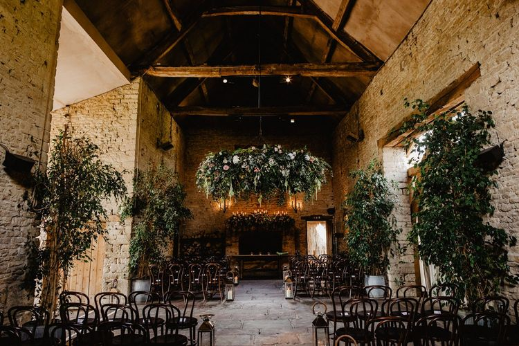 Cripps Barn Wedding Venue in the Cotswolds with Greenery Hanging Chandelier