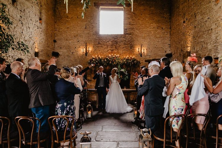 Bride and Groom Celebrating Being Just Married at Cripps Barn Wedding Venue