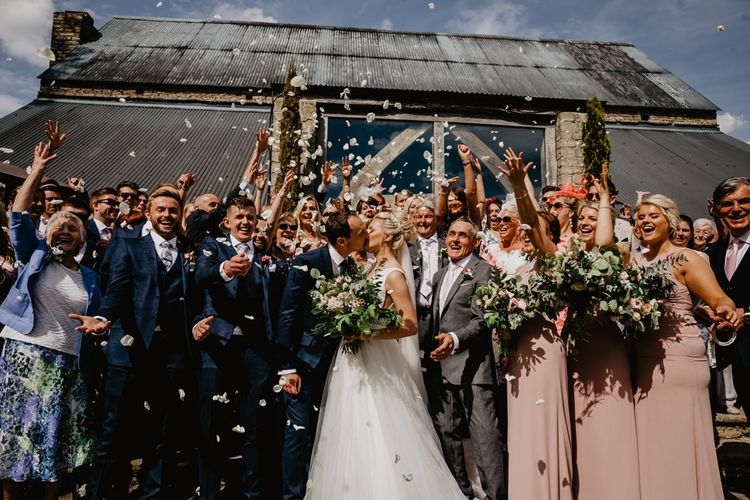 Confetti Moment Outside Cripps Barn with Wedding Party in Navy and Pink Outfits