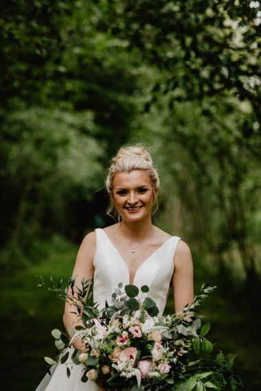 Bride in Stella York Wedding Dress with Romantic Pink, White and Green Bridal Bouquet