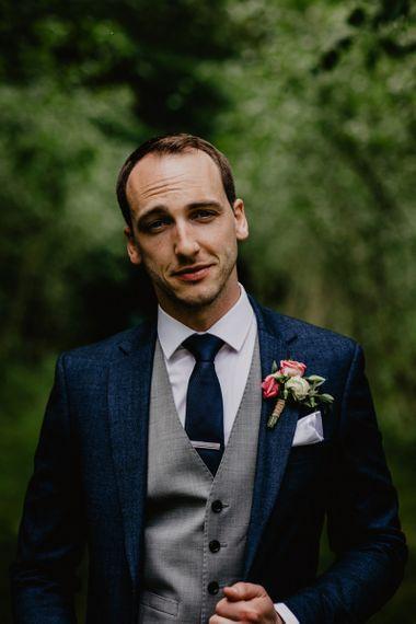 Groom in Navy Wedding Suit with Grey Waistcoat
