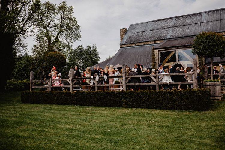 Wedding Guests Enjoying the Drinks Reception on Cripps Barns Veranda