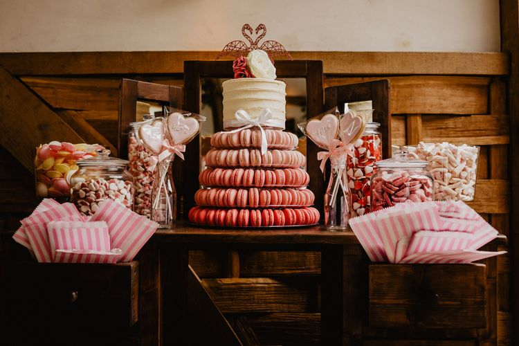 Pink Dessert Table on a Vintage Dresser with Macaron Tower and Retro Sweets in Jars