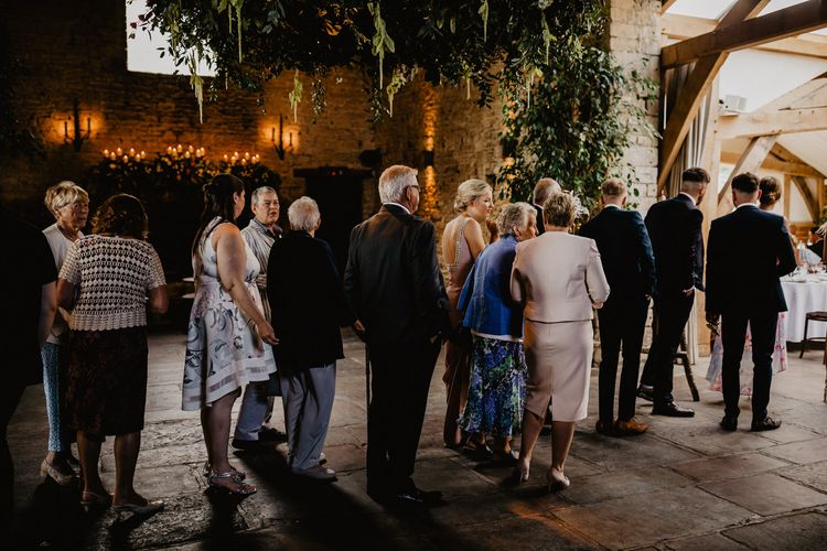 Wedding Guests Queueing for The Wedding Breakfast at Cripps Barn