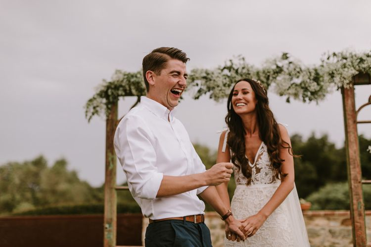 Outdoor Wedding Ceremony | Bride in Lace Inbal Dror Wedding Dress | Groom in Relaxed Chino's & White Shirt | Barcelona Destination Wedding Weekend | Marcos Sanchez Photography
