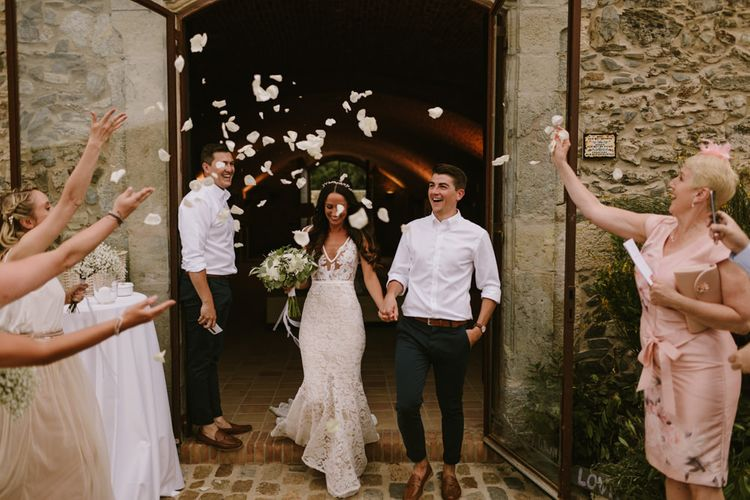 Confetti Moment | Bride in Lace Inbal Dror Wedding Dress | Groom in Relaxed Chino's & White Shirt | Barcelona Destination Wedding Weekend | Marcos Sanchez Photography