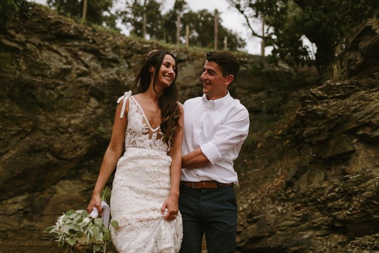 Bride in Lace Inbal Dror Wedding Dress | Groom in Navy Chinos and White Shirt | Barcelona Destination Wedding Weekend | Marcos Sanchez Photography