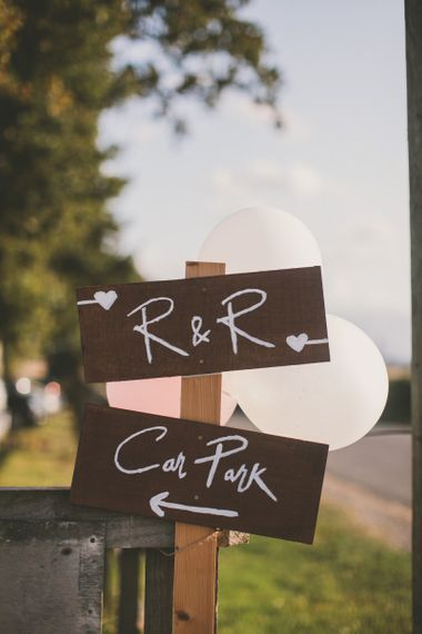 Wooden wedding signs at rustic barn