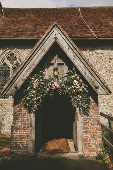Wedding flowers at church ceremony entrance