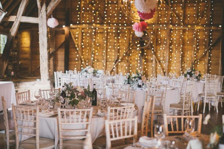 Rustic wedding venue in Kent with pale blue bridesmaid dresses and sweetie table