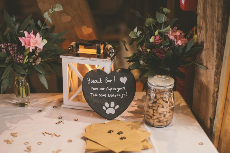 Dog biscuit wedding favours at celebration with pale blue bridesmaid dresses