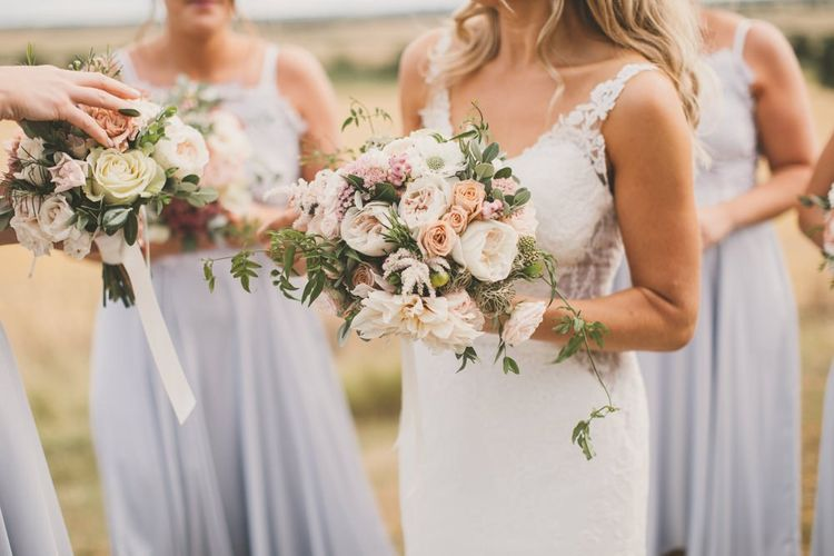 Pale blue bridesmaid dresses with blush wedding bouquets
