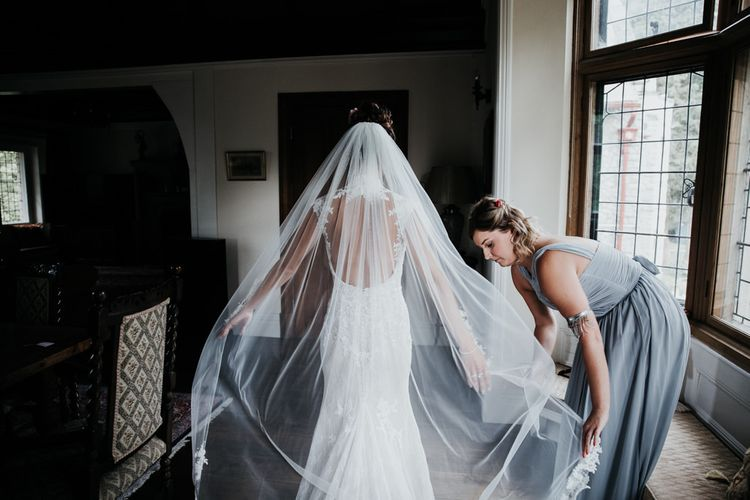 Back of Lace Wedding Dress with Long Veil