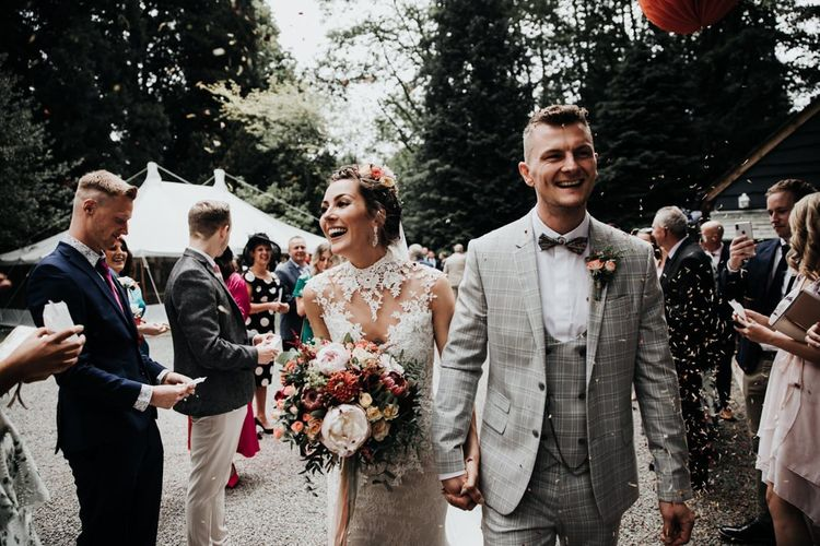Confetti Shot with Sleeveless Wedding Dress and Grey Check Suit