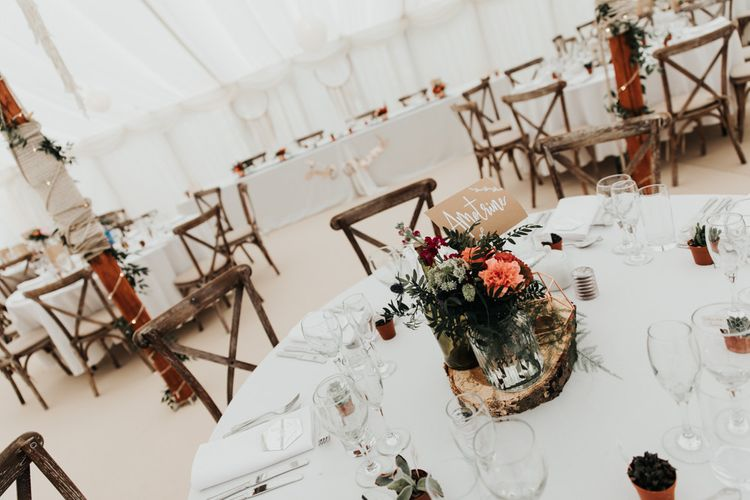 Bright Floral Table Arrangements in Marquee Wedding