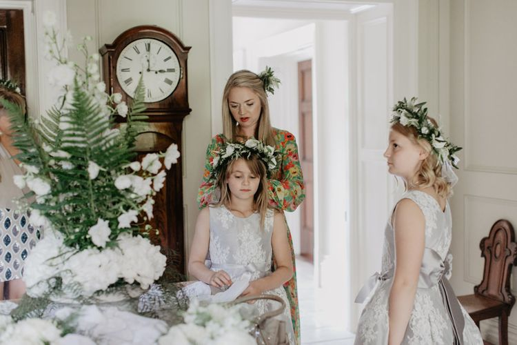 Flower Girls Getting Ready For Wedding With Flower Crowns