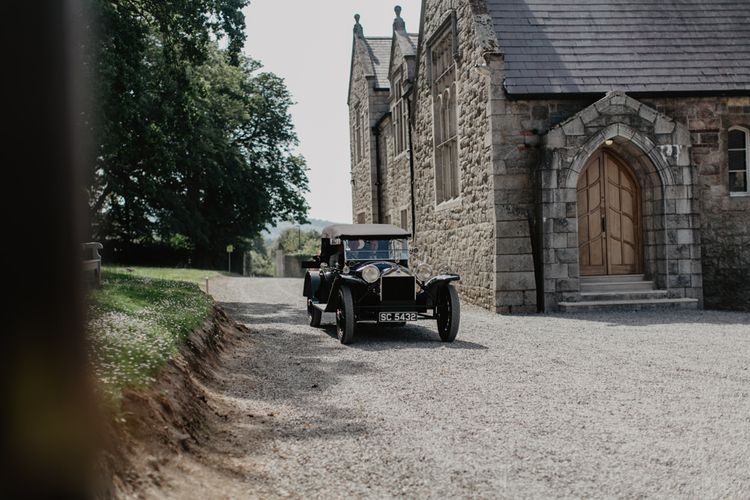 Vintage Car Pulling Up To Church With Bride In For Ceremony