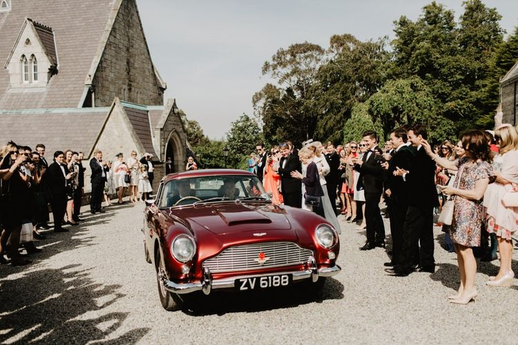 Bride and Groom Drive Off In Vintage Car