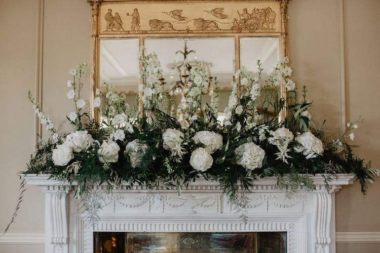 White Flower Decor On Mantlepiece
