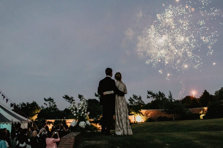 Bride and Groom Watch Fireworks During Evening Reception