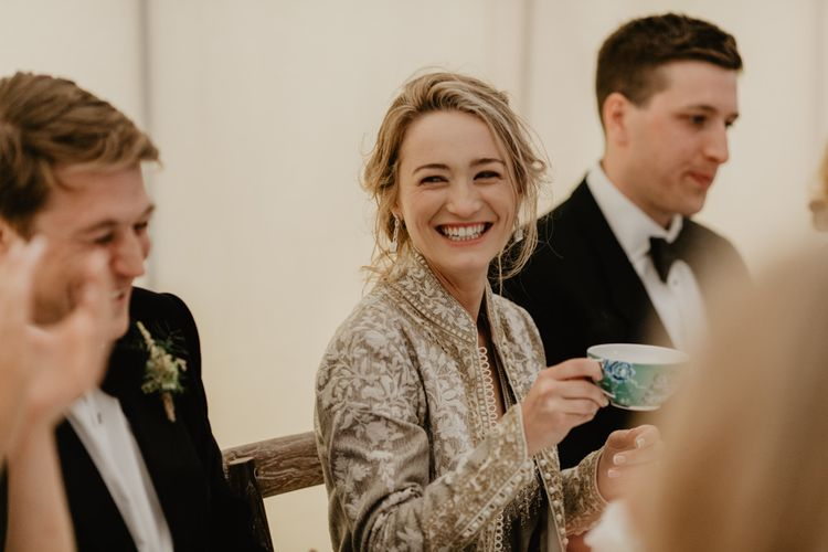 Bride Laughs During Speeches and Drinks From Tea Cup