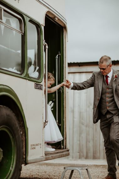 Flower Girl getting off the vintage bus