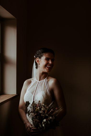 Bride in halter neck Willowby Watters wedding dress