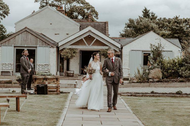 Bridal entrance at outdoor wedding ceremony at Eden Barn