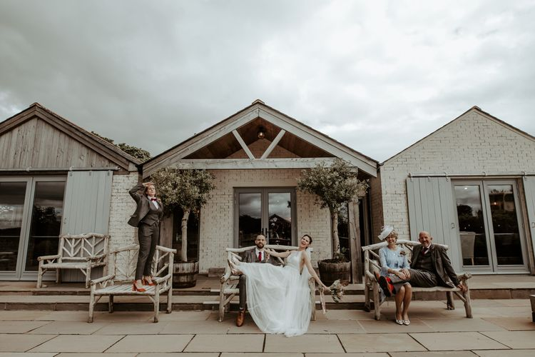 Socially distance wedding party portrait at  Eden Barn by Jo Greenfield