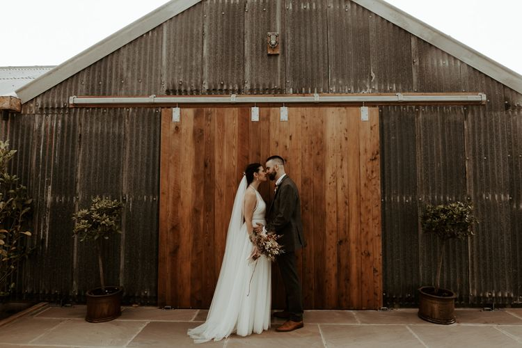Bride and groom portrait at their 1st August 2020 wedding at  Eden Barn