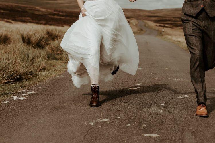 Bride in brown Dr Marten boots for Eden Barn, Lake District  wedding