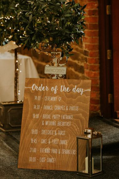 Wooden wedding signs at marquee wedding