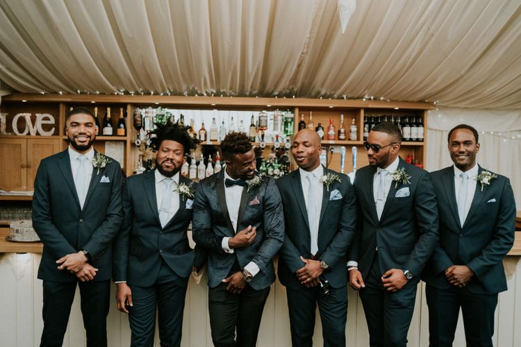 Groom and groomsmen with blue ties at Northamptonshire wedding