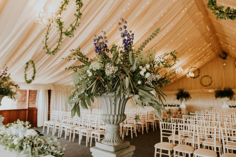 Hoop wedding decor at marquee ceremony with wooden wedding signs