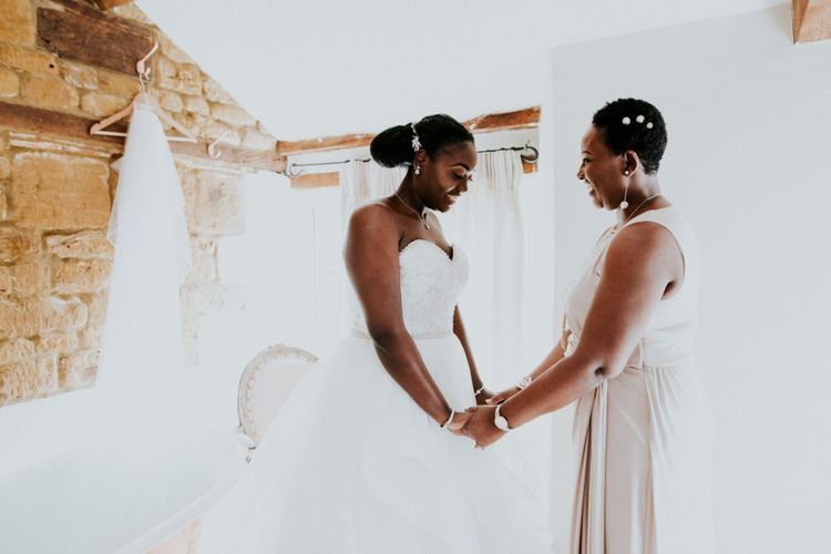 Bride has a moment with mother in strapless wedding dress