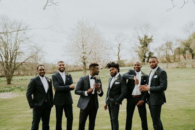 Groomsmen in blue ties with groom in blue dinner jacket
