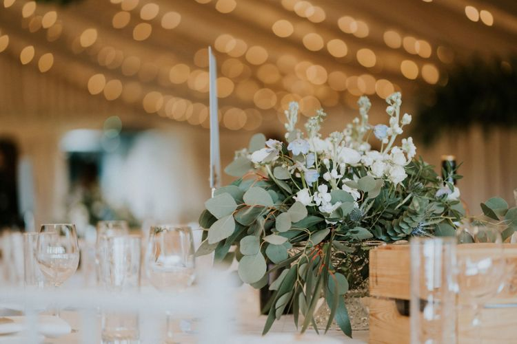 Foliage wedding decor with wooden wedding signs and hoop decoration