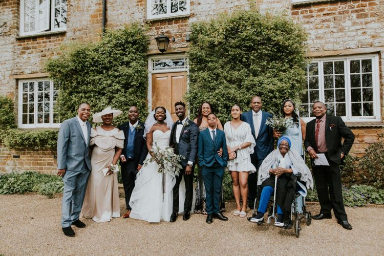 Bride and groom with wedding guests at Crockwell Farm