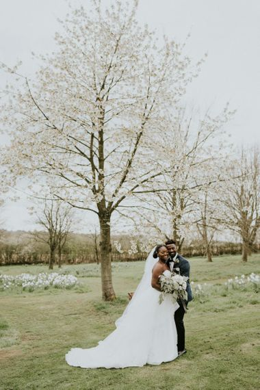 Bride wearing strapless wedding dress with veil at Crockwell Farm