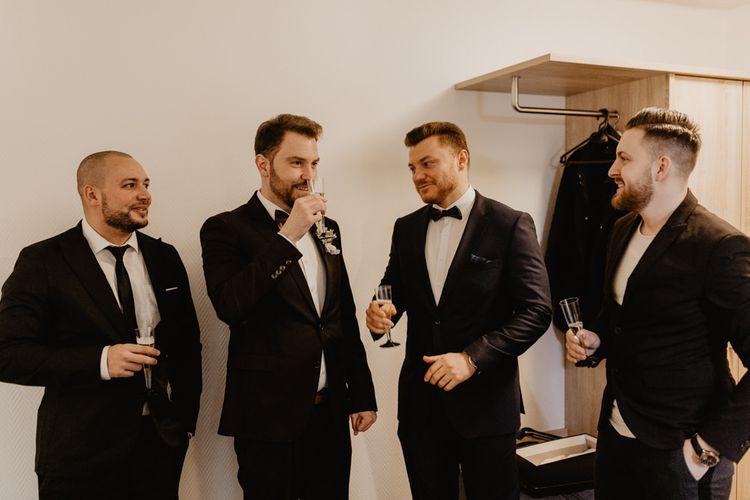 Groom in brown wedding suit with groomsmen