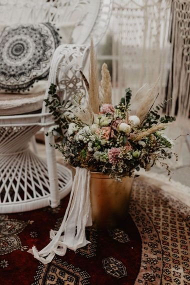 Boho wedding decor with pink flowers