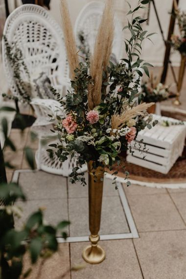 Boho wedding decor with pink wedding flowers