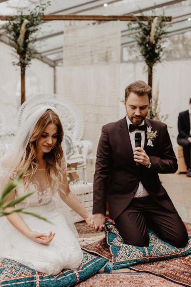 Groom in brown wedding suit