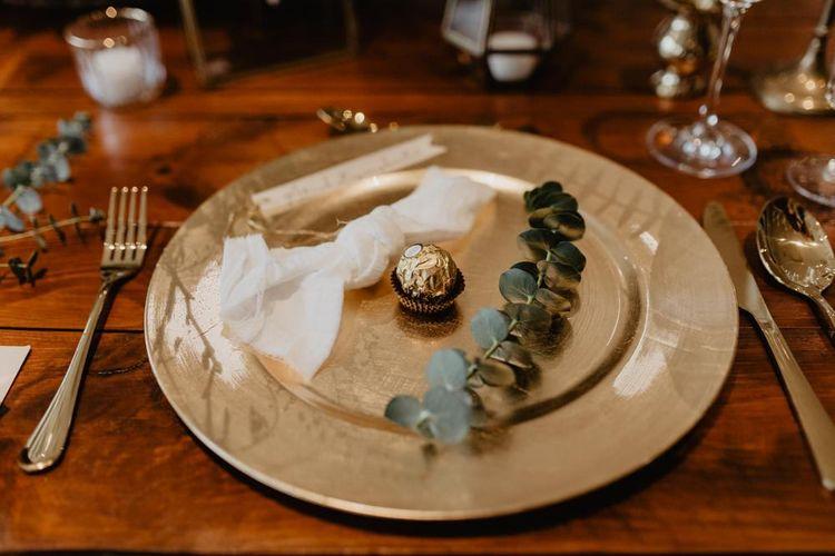 Gold place setting at boho inspired wedding